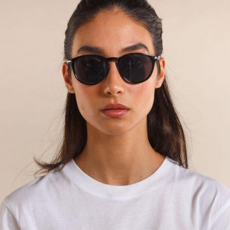 Occhiali da sole arrotondato montatura sottile di color nero