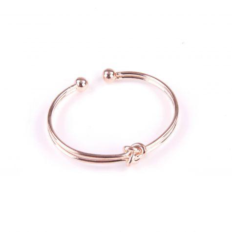 Bracciale aperto con nodo color oro rosato