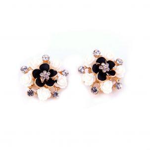 Orecchini clips con fiorellini bianchi e nero